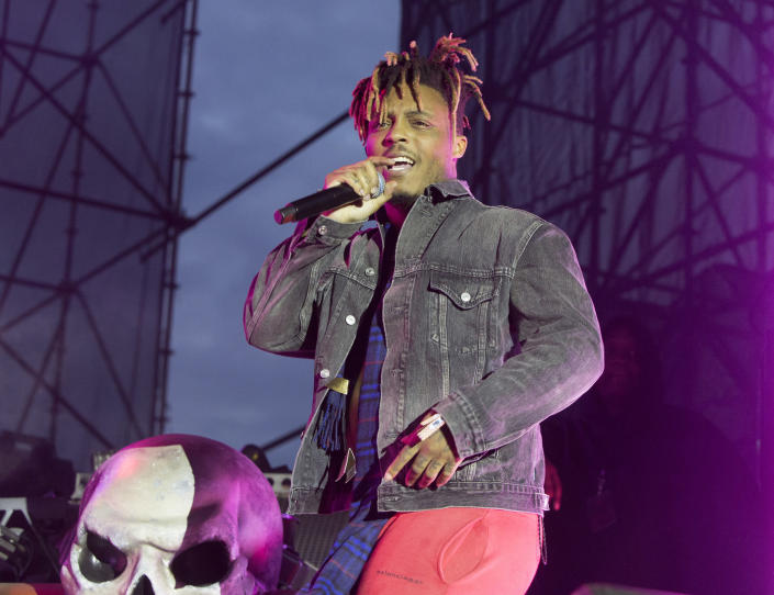 """FILE - In this May 15, 2019 file photo, Juice WRLD performs in concert during his """"Death Race for Love Tour"""" at The Skyline Stage at The Mann Center for the Performing Arts in Philadelphia. The Chicago-area rapper, whose real name is Jarad A. Higgins, was pronounced dead Sunday, Dec. 8 after a """"medical emergency'' at Chicago's Midway International Airport, according to authorities. Chicago police said they're conducting a death investigation. (Photo by Owen Sweeney/Invision/AP, File)"""