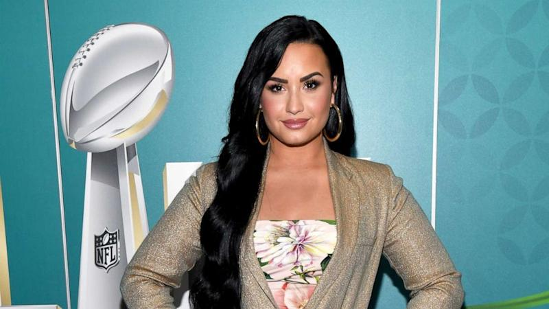 Demi Lovato shows off new butterfly neck tattoo