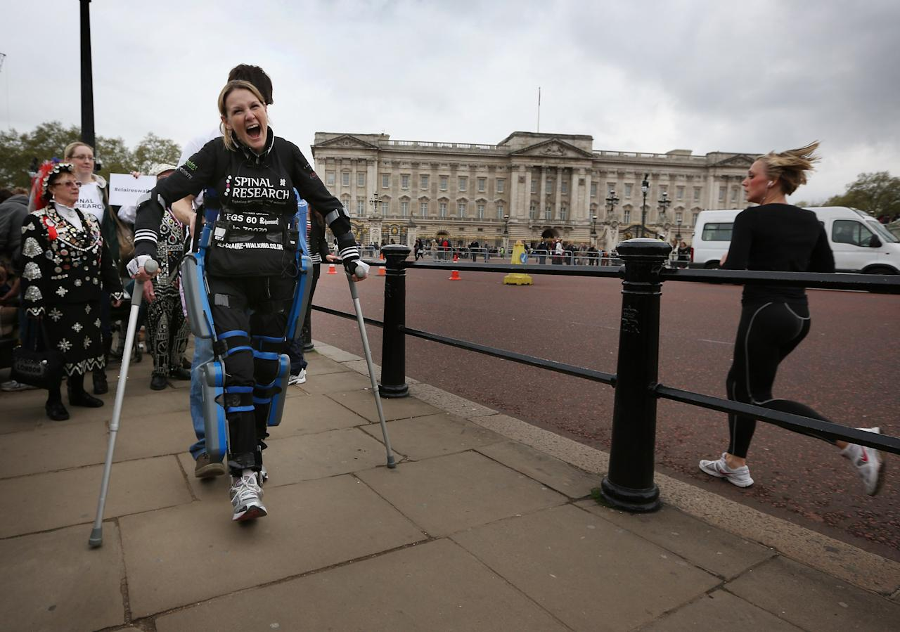 LONDON, ENGLAND - MAY 08:  Claire Lomas shouts with joy as she passes Buckingham Palace as she walks the last mile of the Virgin London Marathon on May 8, 2012 in London, England. Ms Lomas, who is paralysed from the waist down after a riding accident in 2007, has taken 16 days to complete the 26.2 mile route. Starting out with 36,000 other runners she has averaged 2 miles a day with the help of a bionic ReWalk suit.  (Photo by Peter Macdiarmid/Getty Images)