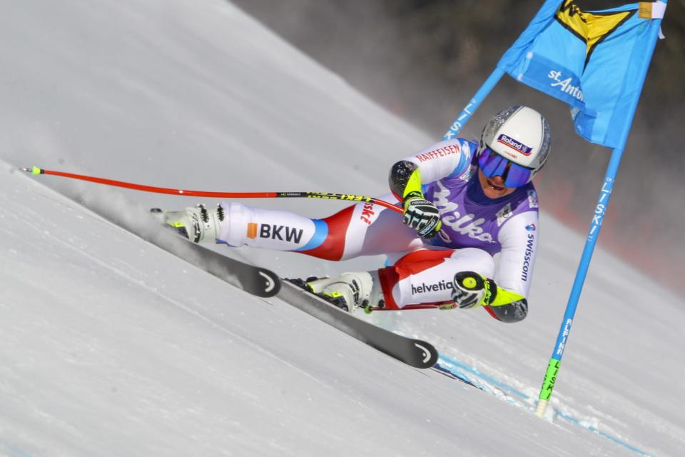 Switzerland's Corinne Suter speeds down the course during an alpine ski, women's World Cup super-G in St. Anton, Austria, Sunday, Jan.10, 2021. (AP Photo/Marco Trovati)