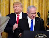 A file photo from January 28, 2020 shows then US president Donald Trump and Israeli Prime Minister Benjamin Netanyahu on the day they announced Trump's Middle East peace plan in the White House