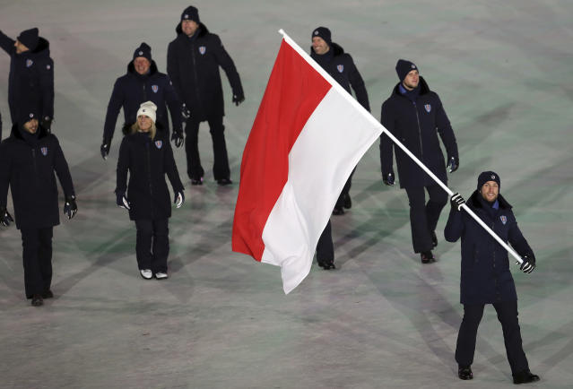 <p>Rudy Rinaldi carries the flag of Monaco, during the opening ceremony of the 2018 Winter Olympics in Pyeongchang, South Korea, Friday, Feb. 9, 2018. (AP Photo/Michael Sohn) </p>
