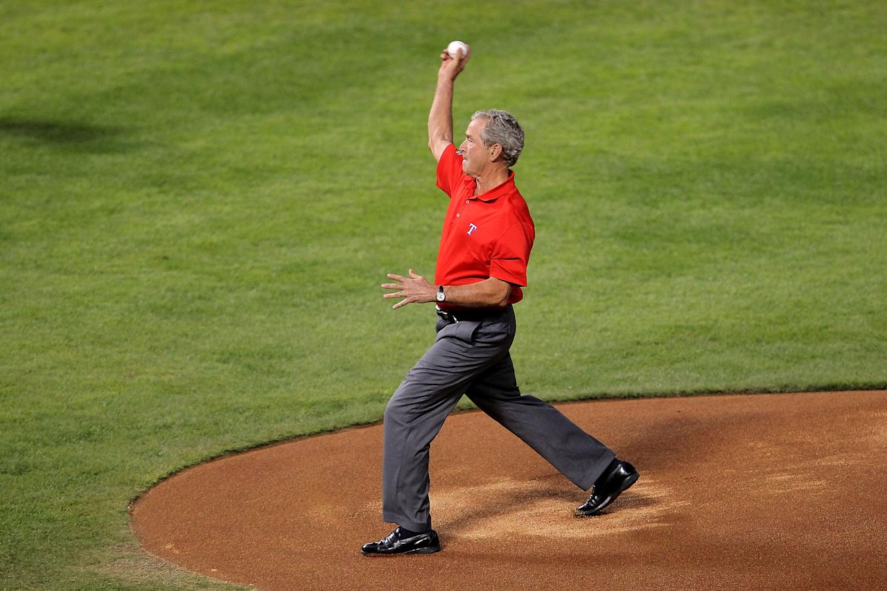 ARLINGTON, TX - OCTOBER 23:  Former president George W. Bush throws out the ceremonial first pitch prior to Game Four of the MLB World Series between the St. Louis Cardinals and the Texas Rangers at Rangers Ballpark in Arlington on October 23, 2011 in Arlington, Texas.  (Photo by Doug Pensinger/Getty Images)