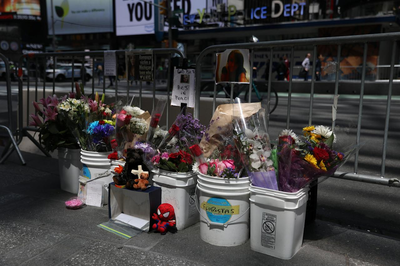 A memorial created in Times Square for Alyssa Elsman is seen along the sidewalk in New York City, New York, U.S., May 24, 2017. REUTERS/Shannon Stapleton