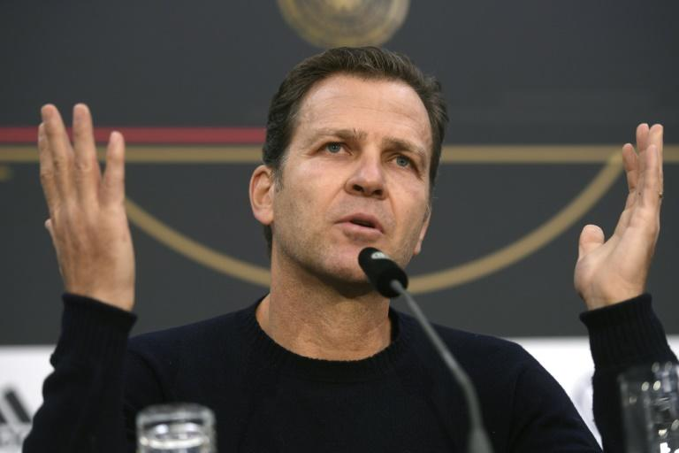 Team director Oliver Bierhoff says Germany want to play more attractive football against Belarus on Saturday in their Euro 2020 qualifier to boost dwindling attendance of their home internationals. (AFP Photo/INA FASSBENDER)