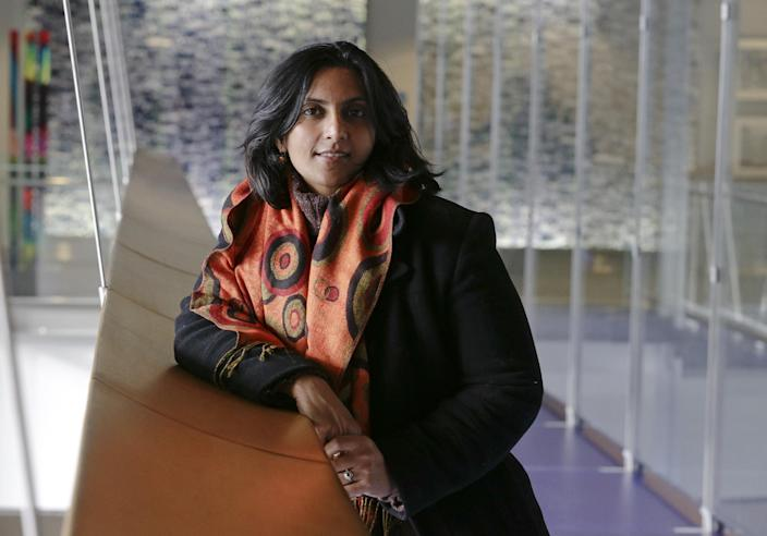 In this photo taken Nov. 4, 2013, Socialist candidate for Seattle City Council Kshama Sawant poses for a photo outside City Council chambers in Seattle. Sawant is challenging four-term Councilman Richard Conlin. (AP Photo/Ted S. Warren)