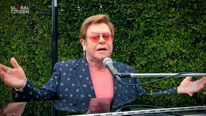 Elton John was among the dozens of artists who took part in a marathon event highlight the efforts of essential workers fighting COVID-19 (AFP Photo/GETTY IMAGES)