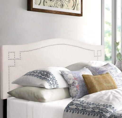"<p>Spruce up your bedroom with this <a href=""https://www.popsugar.com/buy/Adeco-Queen-Upholstered-Headboard-585335?p_name=Adeco%20Queen%20Upholstered%20Headboard&retailer=amazon.com&pid=585335&price=133&evar1=casa%3Aus&evar9=46356293&evar98=https%3A%2F%2Fwww.popsugar.com%2Fphoto-gallery%2F46356293%2Fimage%2F47093721%2FThis-Stylish-Headboard&list1=shopping%2Camazon%2Cfurniture%2Cbedrooms%2Chome%20shopping&prop13=api&pdata=1"" rel=""nofollow"" data-shoppable-link=""1"" target=""_blank"" class=""ga-track"" data-ga-category=""Related"" data-ga-label=""https://www.amazon.com/dp/B088K4ZB5G/ref=sspa_dk_detail_0?psc=1&amp;pd_rd_i=B088K4ZB5G&amp;pd_rd_w=KiUzh&amp;pf_rd_p=48d372c1-f7e1-4b8b-9d02-4bd86f5158c5&amp;pd_rd_wg=g7zQc&amp;pf_rd_r=FVERD6BEP3BBXAPYATFS&amp;pd_rd_r=e400fa72-f66f-4045-a9f5-d533764b8df7&amp;spLa=ZW5jcnlwdGVkUXVhbGlmaWVyPUEzRjQ2TU0yVkpOMkRRJmVuY3J5cHRlZElkPUEwMTU1MjY0MThTOUwxS0VTQjVQViZlbmNyeXB0ZWRBZElkPUEwMDg5NzI3MkVCUlBDWU5VUVhBOCZ3aWRnZXROYW1lPXNwX2RldGFpbCZhY3Rpb249Y2xpY2tSZWRpcmVjdCZkb05vdExvZ0NsaWNrPXRydWU="" data-ga-action=""In-Line Links"">Adeco Queen Upholstered Headboard</a> ($133).</p>"