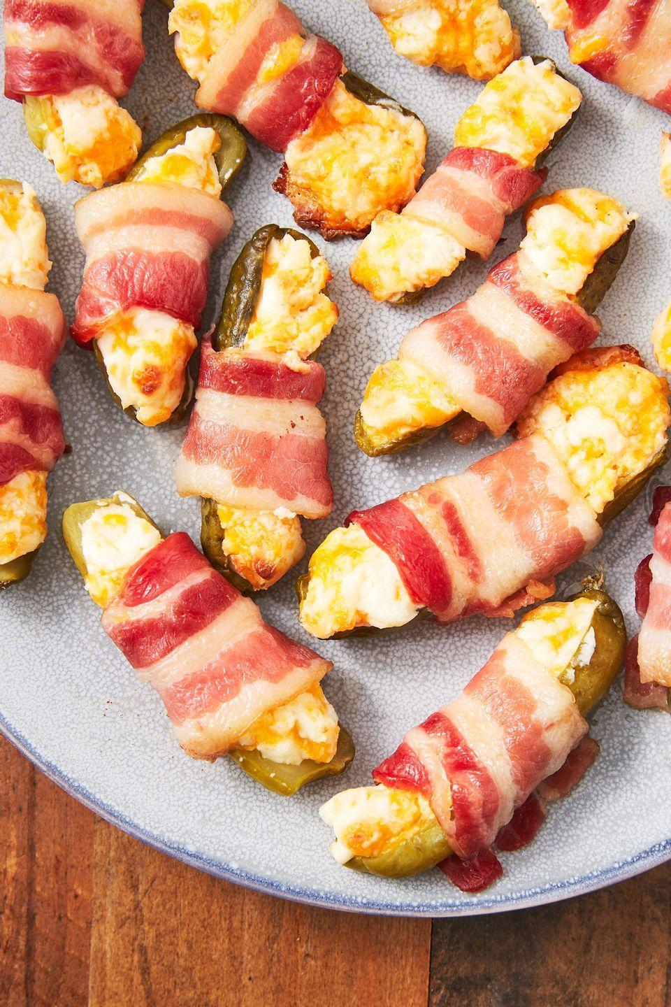 "<p>Pickles are the new pigs in a blanket.</p><p>Get the recipe from <a href=""/cooking/recipe-ideas/recipes/a50084/bacon-wrapped-pickles-recipe/"" data-ylk=""slk:Delish"" class=""link rapid-noclick-resp"">Delish</a>.</p>"