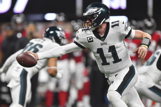 Philadelphia Eagles quarterback Carson Wentz (11) works in the pocket against the Atlanta Falcons during the first half of an NFL football game, Sunday, Sept. 15, 2019, in Atlanta. (AP Photo/John Amis)