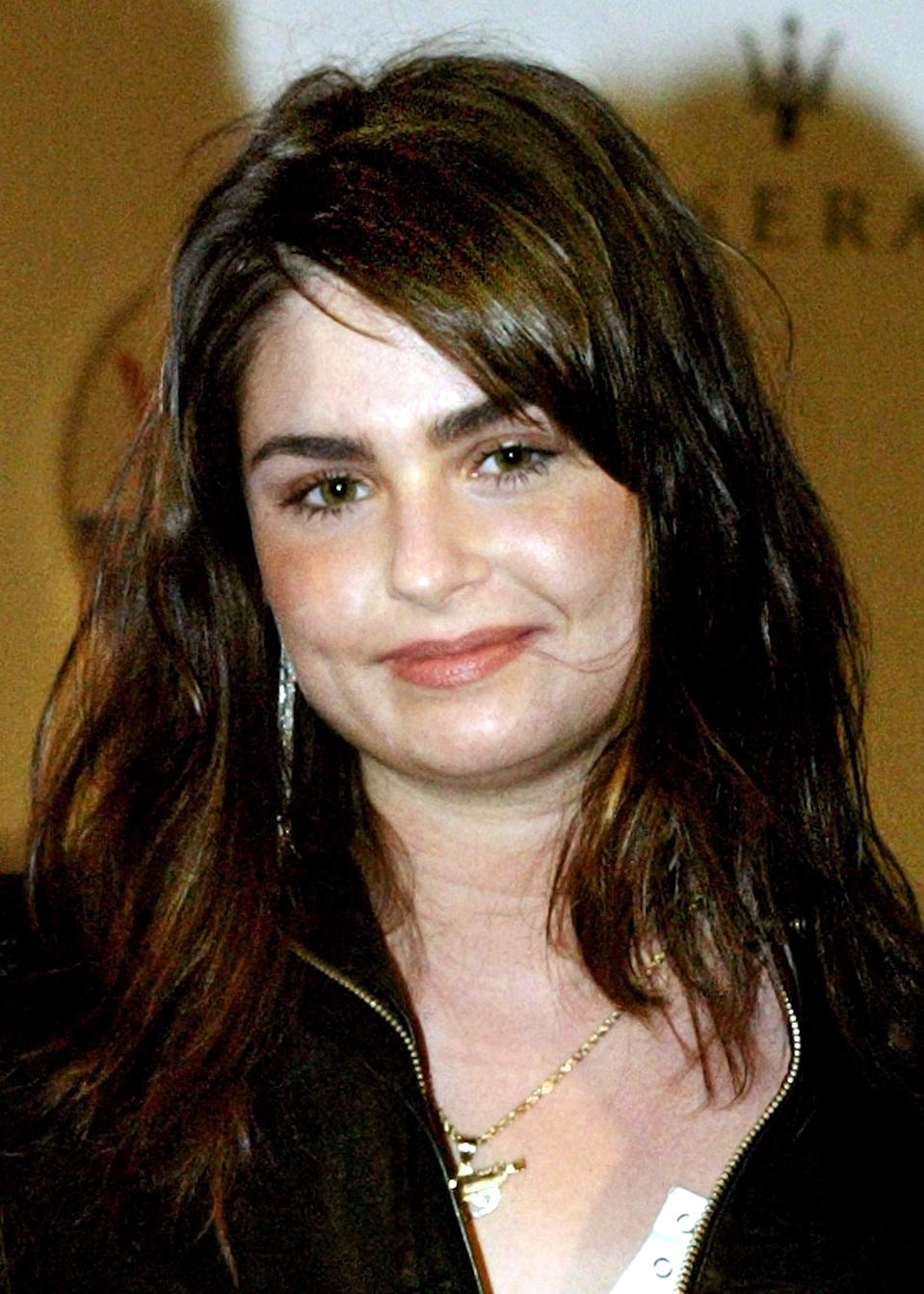 Aimee Osbourne, daughter of Ozzy Osbourne, arrives at a party hosted by Italian automobile manufacturer Maserati, celebrating the 60th Anniversary of the Golden Globes, in Los Angeles January 16, 2003. The Golden Globe Awards will be presented in Los Angeles on January 19. REUTERS/Adrees Latif AL/JDP