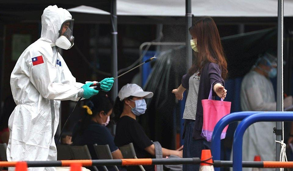 A woman is disinfected as she leaves a Covid-19 testing site in Taipei on Wednesday. Photo: Reuters
