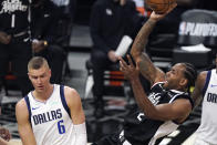 Los Angeles Clippers forward Kawhi Leonard, right, shoots as Dallas Mavericks center Kristaps Porzingis defends during the first half in Game 1 of an NBA basketball first-round playoff series Saturday, May 22, 2021, in Los Angeles. (AP Photo/Mark J. Terrill)