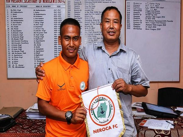 Akbar Khan (L) while signing with Neroca FC (Photo/I-League)