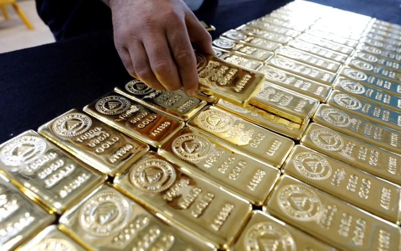 A employee works on 1 kg. gold bars in Ahlatci Metal Refinery in the central Anatolian city of Corum