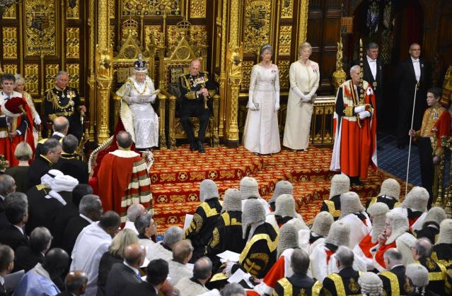 Britain's Queen Elizabeth delivers her speech during the State Opening of Parliament at the House of Lords, alongside Prince Philip, centre right, in London Wednesday May 8, 2013. The State Opening of Parliament marks the formal start of the parliamentary year, the Queen delivered a speech which set out the government's agenda for the coming year. (AP Photo/Toby Melville, Pool)