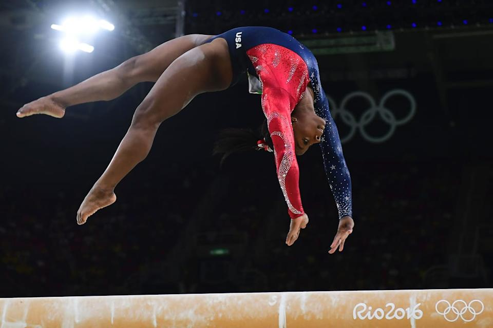 "<div class=""inline-image__caption""><p>US gymnast Simone Biles competes in the qualifying for the women's Beam event of the Artistic Gymnastics at the Olympic Arena during the Rio 2016 Olympic Games in Rio de Janeiro on August 7, 2016.</p></div> <div class=""inline-image__credit"">Emmanuel Dunand/Getty</div>"