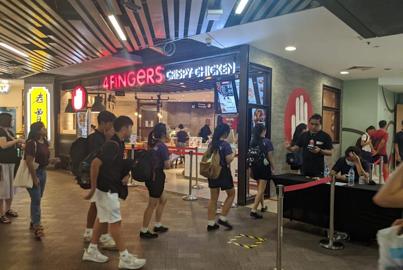 Patrons queueing to get into an area of Causeway Point on 27 March, 2020. (PHOTO: Yahoo News Singapore)