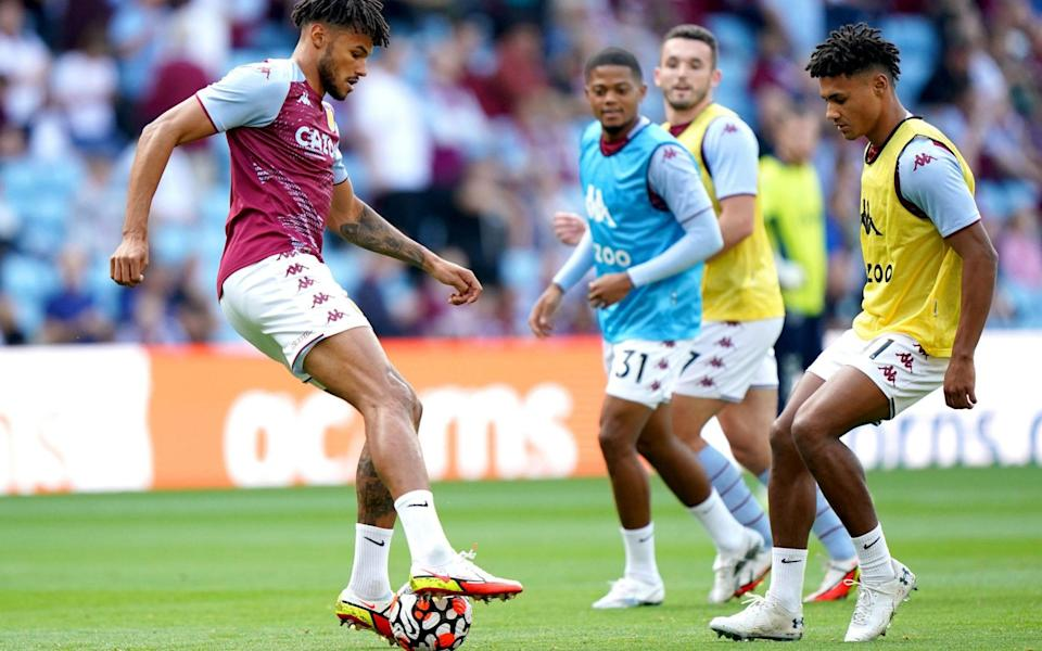 Aston Villa's Tyrone Mings (left) warms up on the pitch ahead of the Premier League match at Villa Park. - Tim Goode/PA Wire