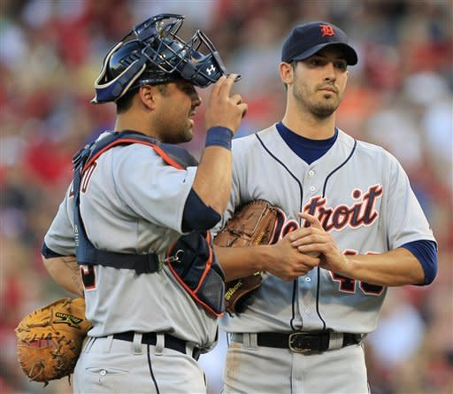 Detroit Tigers starting pitcher Rick Porcello, right, talks with catcher Gerald Laird, left, in the third inning of a baseball game against the Cincinnati Reds, Friday, June 8, 2012, in Cincinnati. (AP Photo/Al Behrman)