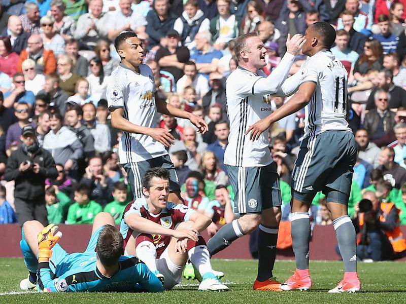 Wayne Rooney celebrates after Anthony Martial puts Manchester United ahead of Burnley: Getty