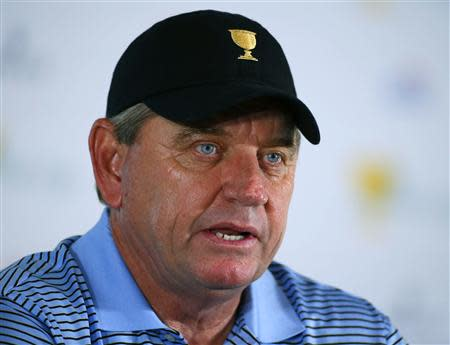 International captain Nick Price, of Zimbabwe, speaks at a press conference during the first practice round for the 2013 Presidents Cup golf tournament at Muirfield Village Golf Club in Dublin, Ohio October 1, 2013. REUTERS/Jeff Haynes
