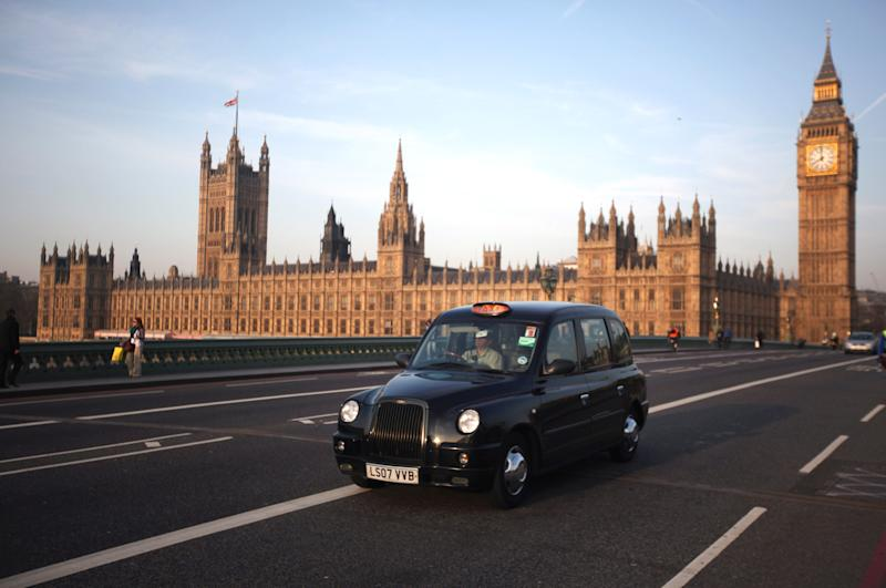 LONDON, ENGLAND - MARCH 28: A black taxi cab makes its way over Westminster Bridge on March 28, 2012 in London, England. (Photo by Dan Kitwood/Getty Images)