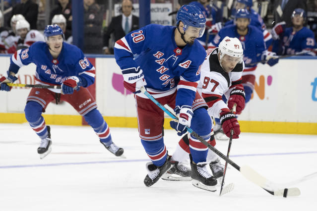 New York Rangers left wing Chris Kreider (20) competes for the puck against New Jersey Devils left wing Nikita Gusev (97) during the second period of a preseason NHL hockey game Wednesday, Sept. 18, 2019, at Madison Square Garden in New York. (AP Photo/Mary Altaffer)
