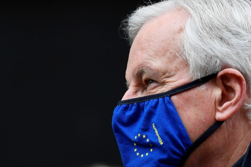 European Union's chief Brexit negotiator Michel Barnier wearing a face mask walks to Brexit trade negotiations in London