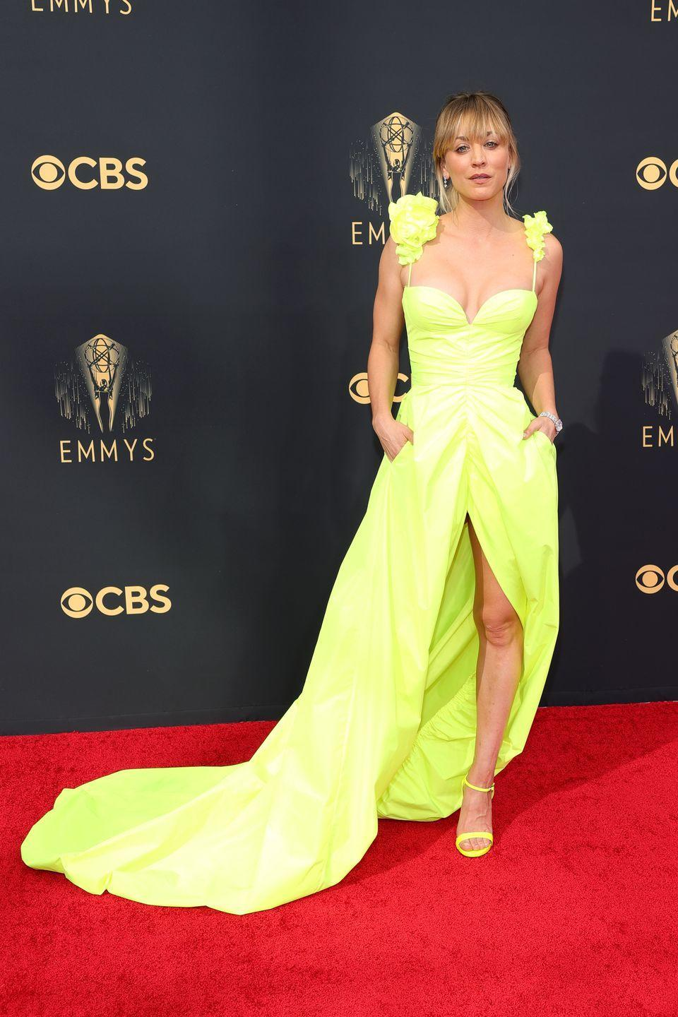 <p>Neon was a big trend for the night, and Kaley Cuoco was on board. The actress chose a chic gown by Vera Wang, which featured floral detail on the strappy shoulders and a thigh-high slit. She paired the look with matching shoes, De Beers diamonds and a messy updo.</p>