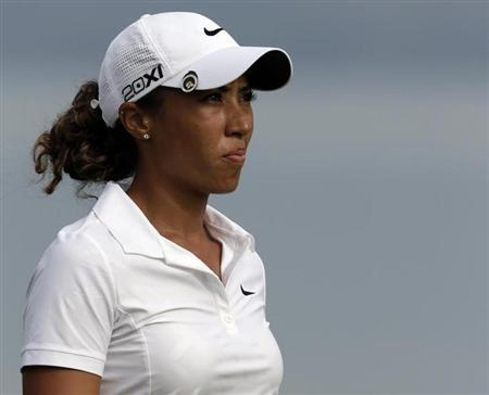 Cheyenne Woods of the U.S. looks her approach shot onto the fifth green during the third round of the 18th Evian Masters golf tournament in Evian July 28, 2012. REUTERS/Denis Balibouse