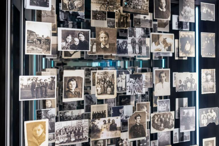 Pictures of people exiled to Siberia are displayed in the museum (AFP/Wojtek RADWANSKI)