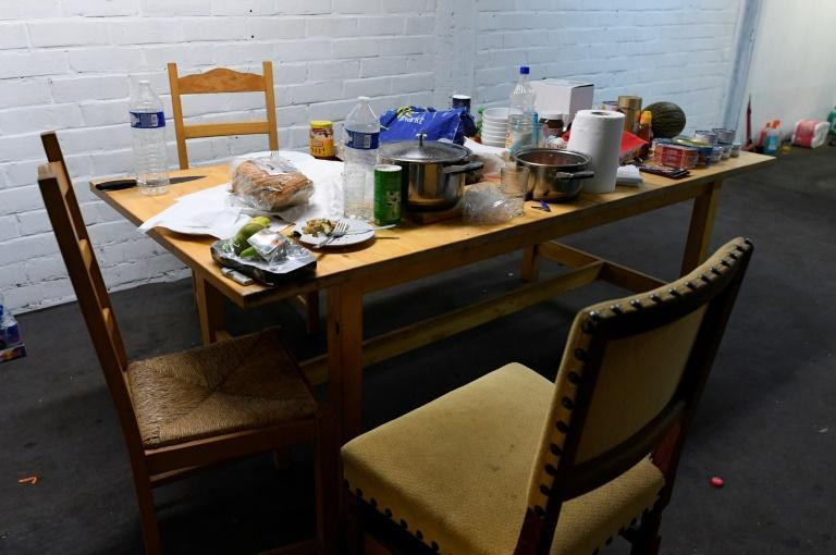 The workers in the illegal cigarette plant abandoned their breakfast when Belgian customs officers stormed in