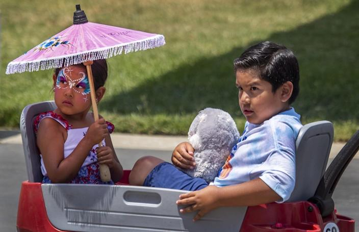 Ryann Garcia, 5, and Andrian Garcia, 8, of Los Alamitos, are pulled in a wagon.
