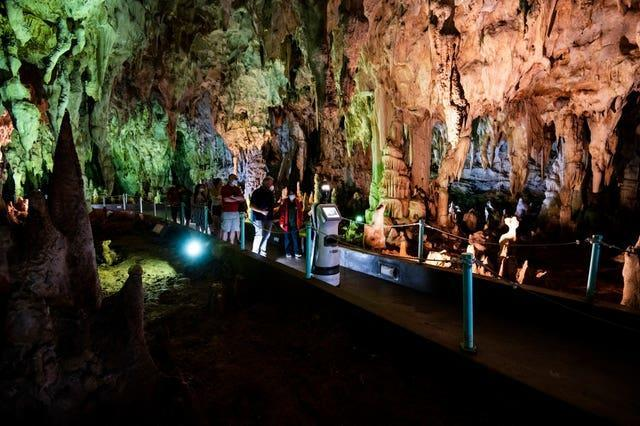 Persephone guides visitors inside the Alistrati cave, north-east of Thessaloniki, Greece