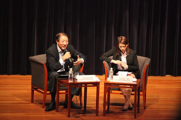 Singapore Deputy Prime Minister Teo Chee Hean leans forward in his chair as he engages students in the audience. (Photo courtesy: Singaporeans in Conversation)