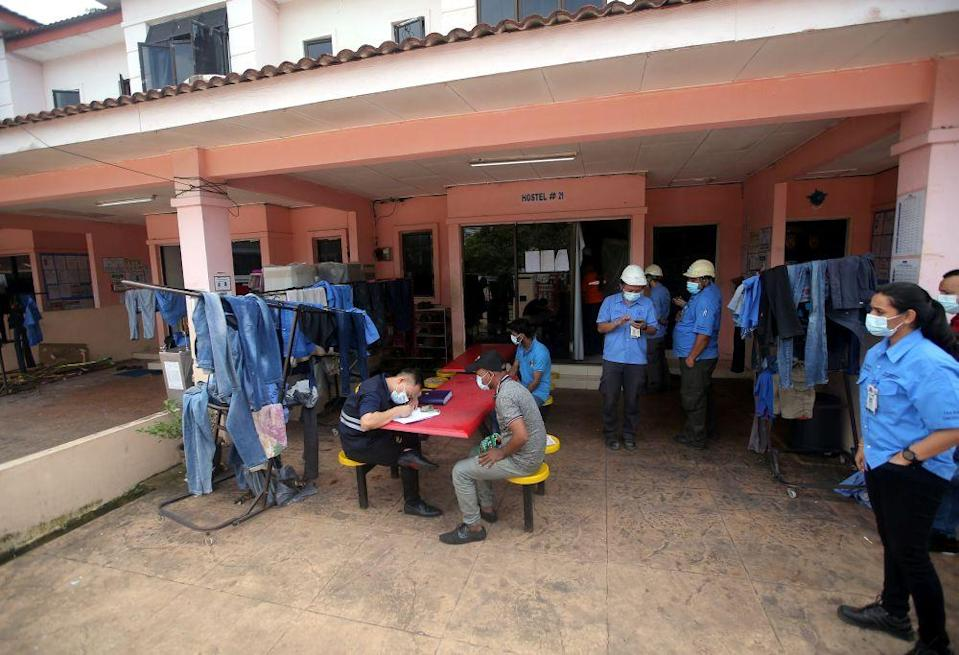 Officers from the Labour Department conduct checks on a worker's hostel in Tasek, Ipoh November 26, 2020. — Picture by Farhan Najib