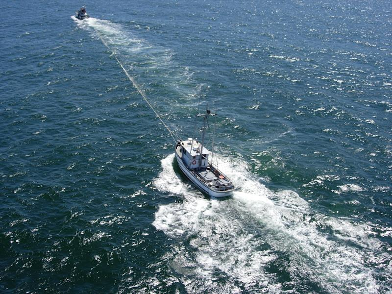 In this photo provided by the U.S. Coast Guard, a Coast Guard 47-foot motor lifeboat  tows the disabled fishing vessel Dahlia to Florence, Ore. on Friday July 8, 2011. The crew of the Dahlia was adrift for five days after their ship's battery lost power. (AP Photo/Coast Guard)