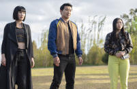 """This image released by Marvel Studios shows, from left, Meng'er Zhang, Simu Liu and Awkwafina in a scene from """"Shang-Chi and the Legend of the Ten Rings."""" (Jasin Boland/Marvel Studios via AP)"""