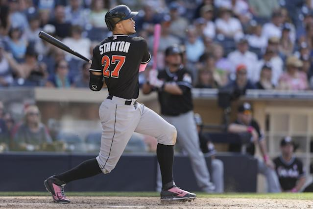 Miami Marlins right fielder Giancarlo Stanton hits a single while batting against the San Diego Padres during the eighth inning of a baseball game Sunday, May 11, 2014, in San Diego. (AP Photo/Gregory Bull)