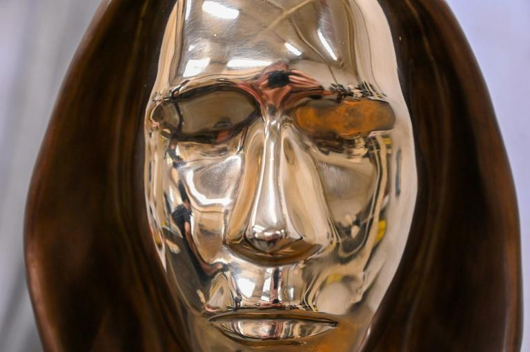 To reflect the mystery surrounding the true identity of bitcoin's founder, sculptors Tamas Gilly and Reka Gergely turned the face into a sort of mirror (AFP/ATTILA KISBENEDEK)