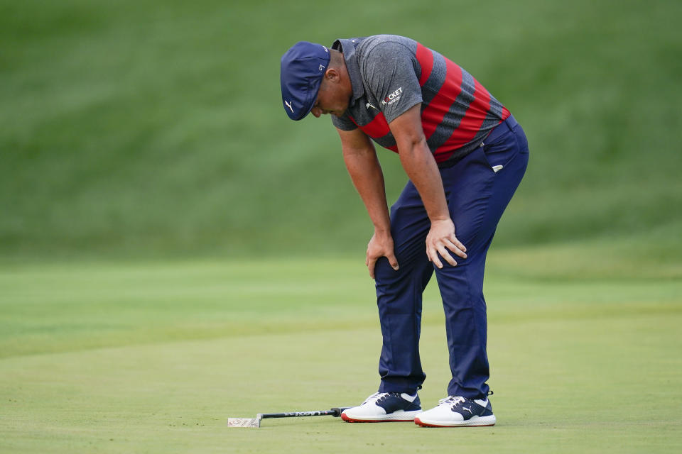 Bryson DeChambeau reacts after missing a putt on the 17th green, the third playoff hole against Patrick Cantlay during the final round of the BMW Championship golf tournament, Sunday, Aug. 29, 2021, at Caves Valley Golf Club in Owings Mills, Md. (AP Photo/Julio Cortez)