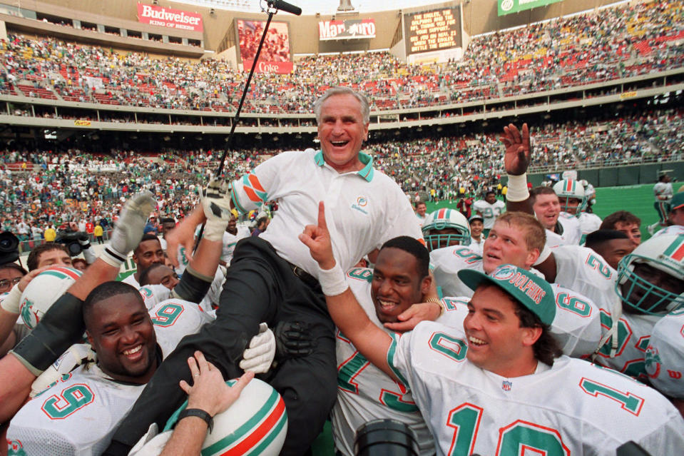 FILE - In this Nov. 14, 1993, file photo, Miami Dolphins coach Don Shula is carried on his team's shoulders after his 325th victory, against the Philadelphia Eagles in Philadelphia. Sports in 2020 was an unending state of mourning. Sports in 2020 was an unending state of mourning. Football lost a big piece of its heart: Don Shula, Gale Sayers, Paul Hornung, Bobby Mitchell. (AP Photo/ George Widman, File)