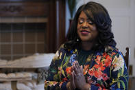 """Tiffany Crutcher pauses during an interview in Tulsa, Okla., on Monday, April 12, 2021. She says, terrorized by the Tulsa Race Massacre, """"My father's grandmother, Rebecca Brown Crutcher, had to flee Greenwood in fear of her life."""" But the family stayed in Tulsa, enduring some of the same post-massacre hardships that generations of Black Tulsans endured: urban renewal, inequality on the north side and police brutality. (AP Photo/Sue Ogrocki)"""