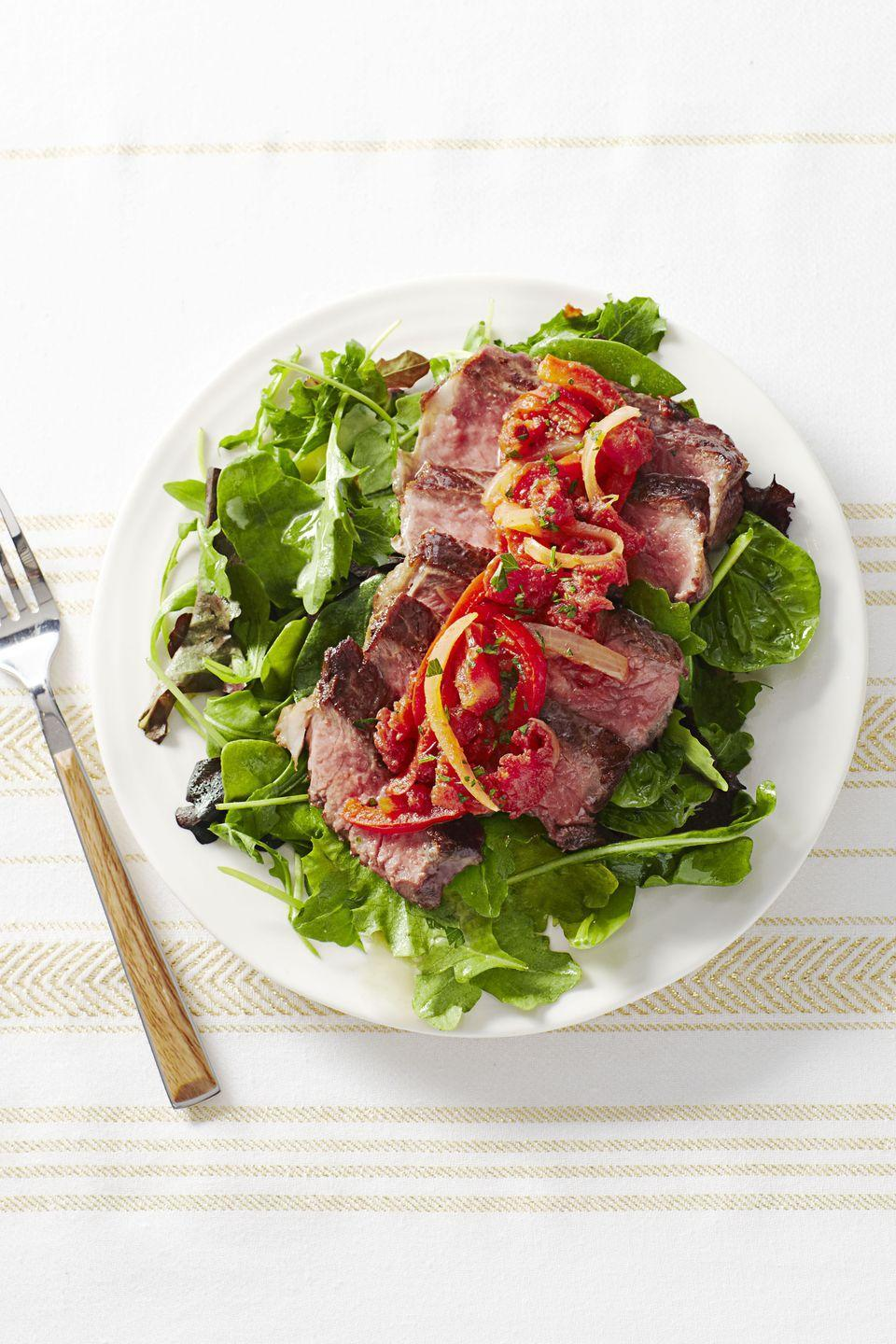 """<p>This easy dinner is a Paleo dieter's dream — all the protein, none of the processed foods <em>and </em>it's ready in 10. </p><p><em><a href=""""https://www.goodhousekeeping.com/food-recipes/a16803/steak-pizzaiolo-recipe-ghk0115/"""" rel=""""nofollow noopener"""" target=""""_blank"""" data-ylk=""""slk:Get the recipe for Steak Pizzaiolo »"""" class=""""link rapid-noclick-resp"""">Get the recipe for Steak Pizzaiolo »</a></em> </p>"""