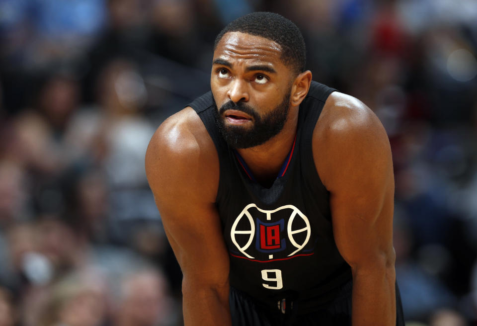 FILE - In this Jan. 21, 2017, file photo, Los Angeles Clippers guard Alan Anderson (9) looks up during a break in the second half of an NBA basketball game against the Denver Nuggets in Denver. Eighteen former NBA players, including Anderson, have been indicted on charges alleging they defrauded the league's health and welfare benefit plan out of about $4 million, according to an indictment Thursday, Oct. 7, 2021. (AP Photo/David Zalubowski, File)