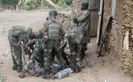 Congolese soldiers from the Armed Forces of the Democratic Republic of Congo (FARDC) assemble their ammunition during their offence against the rebels from the Democratic Forces for the Liberation of Rwanda (FDLR) in Kirumba village of Rutshuru territory in eastern Democratic Republic of Congo, February 28, 2015. REUTERS/Kenny Katombe