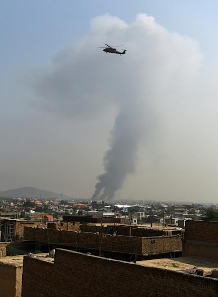 A US military helicopter flies near the site of a massive explosion that killed 16 near the Green Village in Kabul on September 3, 2019 (AFP Photo/Wakil KOHSAR)