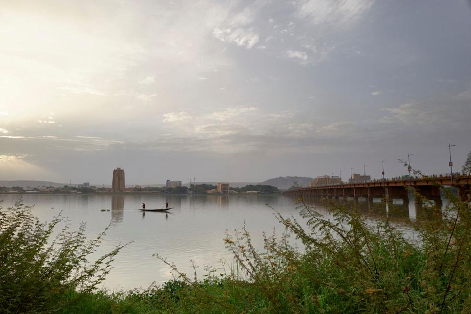 Two men fish in the Niger River by the Martyrs Bridge in Bamako.