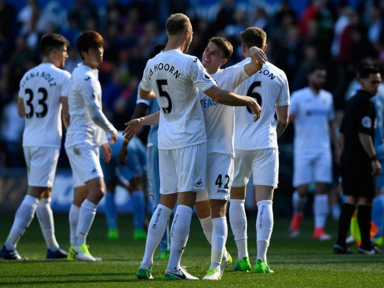 Fernando Llorente and Tom Carroll seal victory as Swansea stop the rot against Stoke